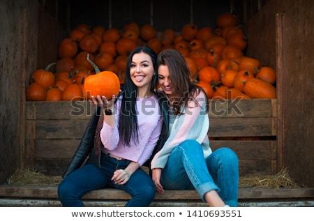 Foto stock: Fashionable Beautiful Young Girl At The Autumn Pumpkin Patch Bac