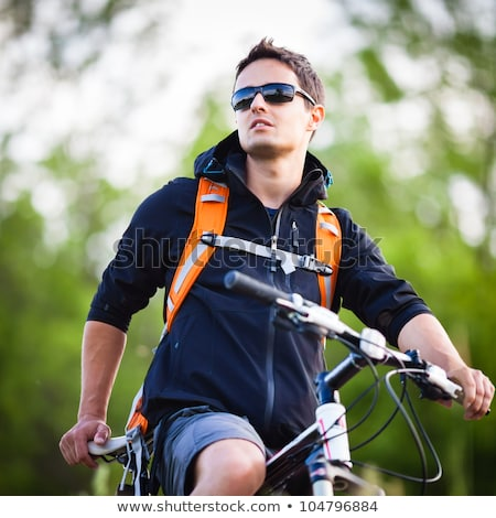 happy young man with bicycle outdoors in summer Stock photo © dolgachov