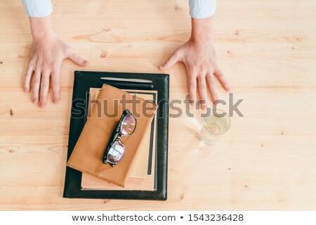 Empresario manos vidrio agua cuadernos Foto stock © pressmaster