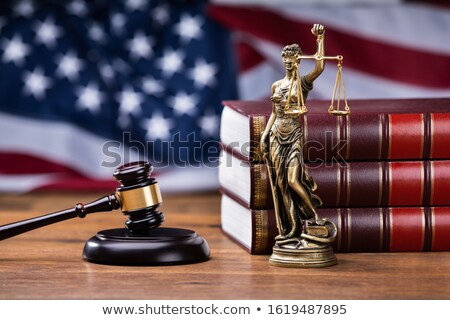 Gavel With Golden Scale In Front Of US Flag Stock photo © AndreyPopov