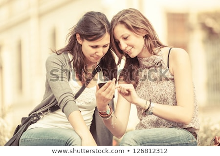 outdoor portrait young woman talk on a cellular telephone stock photo © ilolab