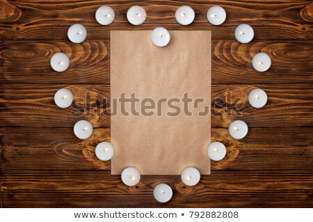 presents and burning heart shaped candle with blank card stock photo © andreykr