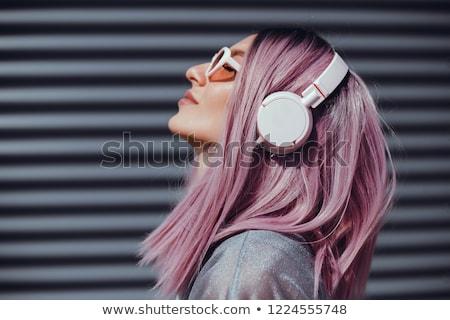 Gülen kız kulaklık yalıtılmış beyaz Stok fotoğraf © MilosBekic