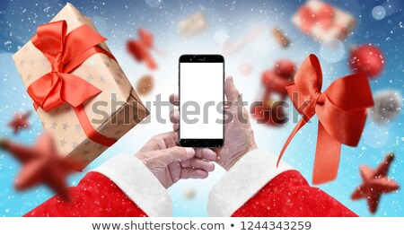 Cellphone user surrounded by boxes Stock photo © photography33