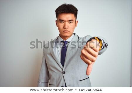 бизнесмен · вниз · знак · стороны · мужчин - Сток-фото © ambro