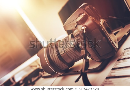 Professional DSLR camera with telephoto lens Stock photo © Arsgera