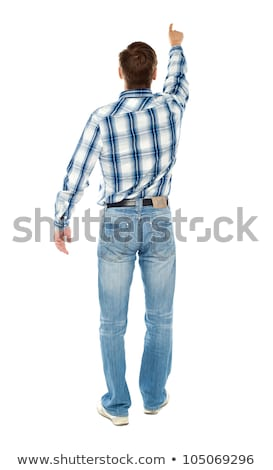 Rear view of a male indicating towards copy space Stock photo © stockyimages