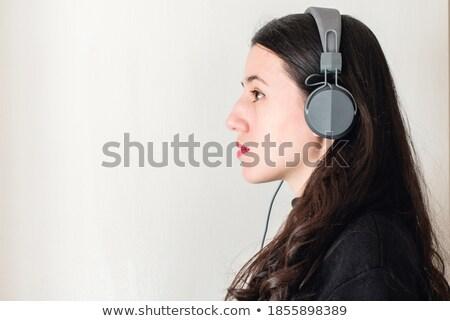 белый шум брюнетка наушники великолепный молодые Сток-фото © lithian