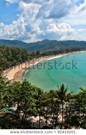 Tropical beach, in a cozy cove surrounded by hills Stock photo © RuslanOmega
