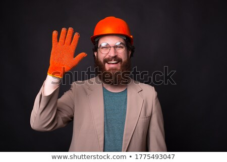 businessman in a hardhat saluting stock photo © photography33