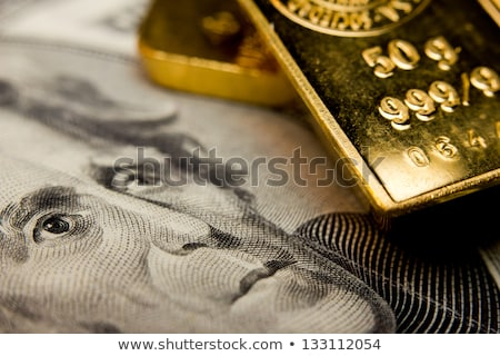 gold bar with bank notes Stock photo © pterwort