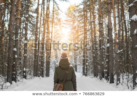 Woman behind snowy tree Stock photo © photography33