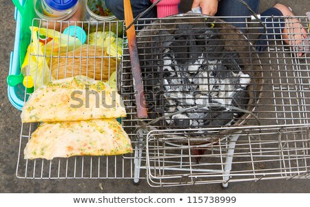 Rice paper meal being made on a barbeque Stock photo © michaklootwijk
