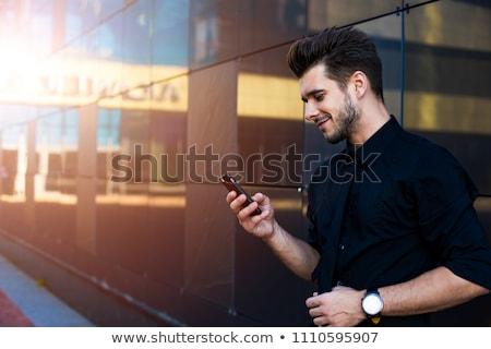 Businessman read good news on smartphone, business building inte Stock photo © adamr