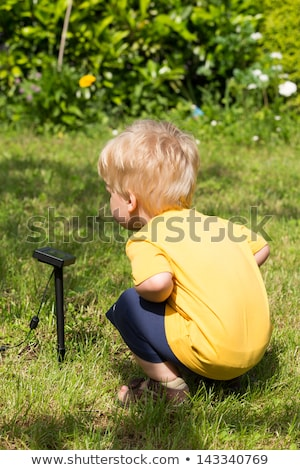 Kid interested by solar battery Stock photo © doupix