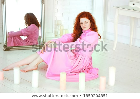 Charming woman at sunny day at studio Stock photo © vetdoctor