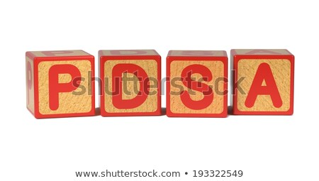 Work on Colored Wooden Childrens Alphabet Block. Stock photo © tashatuvango