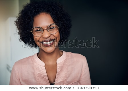 Portrait of happy Young woman with black glasses standing. Stock photo © luckyraccoon