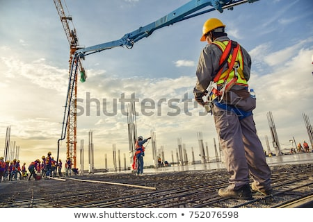 construction worker on a building in sunset stock photo © stevanovicigor