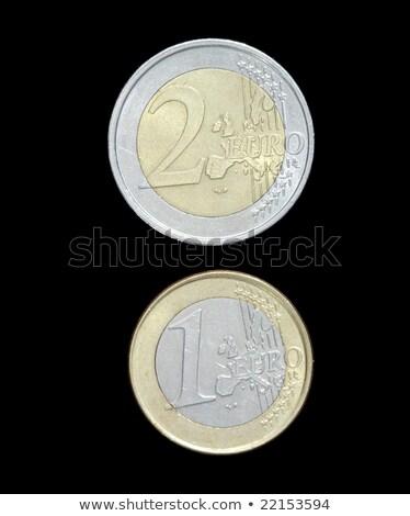 two european coins on a black background stock photo © tashatuvango