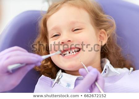 Tandarts onderzoeken tanden tandartsen stoel Stockfoto © wavebreak_media