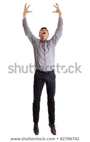 Business man hang on something Stock photo © fuzzbones0