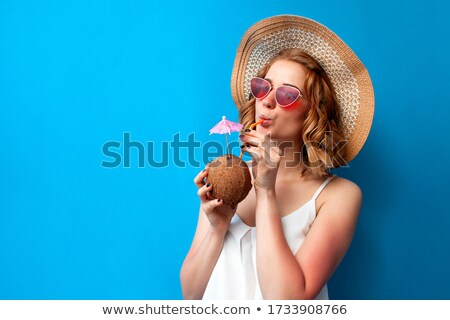 Girl holding cocktail in coconut  Stock photo © deandrobot
