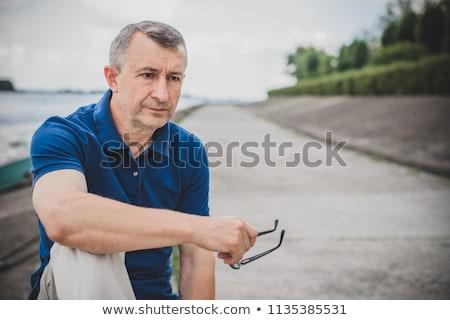 sad middle aged man Stock photo © dolgachov
