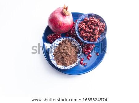 top view of organic dried pomegranate seeds punica granatum stock photo © ziprashantzi