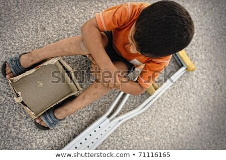 éhes · gyerek · utca · mankók · vmi · mellett · pénz - stock fotó © zurijeta