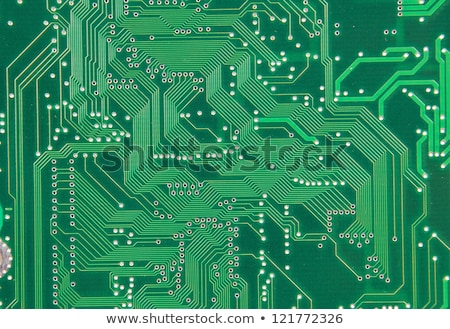 close up of computer circuit board in green with transistors and stock photo © kayros