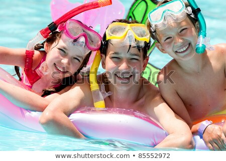 Young boy in flippers playing in a pool Stock photo © ozgur
