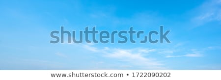 Cumulus cloudscape with blue sky above. Stock photo © tuulijumala