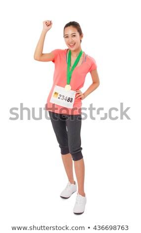 Genç kadın altın kazanan madalya yalıtılmış Stok fotoğraf © Elnur