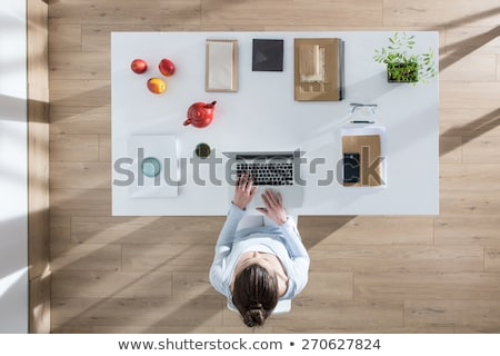 Top view of businesswoman sitting at wooden table and working wi Stock photo © adam121