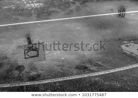 reflection of basketball hoop in the puddle stock photo © stevanovicigor