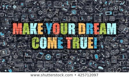 Foto d'archivio: Make Your Dream Come True On Dark Brick Wall