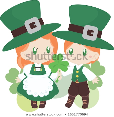 Boy and girl holding shamrocks Stock photo © bluering