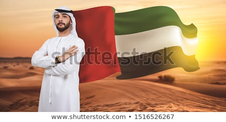 Bearded arabic businessman in national clothes Stock photo © studioworkstock