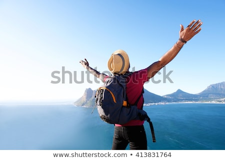 Back view of young african guy Stock photo © deandrobot