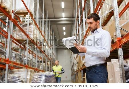 empresário · escrita · clipboard · armazém · pessoas - foto stock © dolgachov