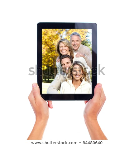 elderly woman on studio white background with tablet Stock photo © Lopolo