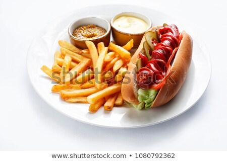 Plaka patates kızartması lezzetli sosisli sandviç ahşap yeşil Stok fotoğraf © dashapetrenko
