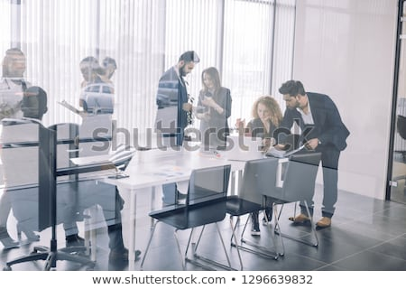 People Planning Strategy and Discussing Topic Stock photo © robuart