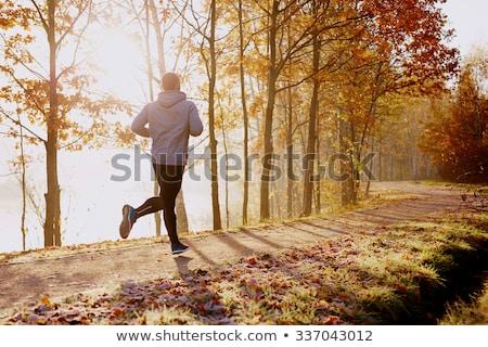 Fitness sport man lopen zonsondergang Stockfoto © Freedomz