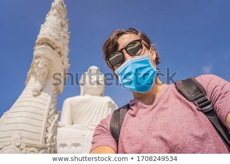 Człowiek turystycznych duży Buddy posąg wysoki Zdjęcia stock © galitskaya