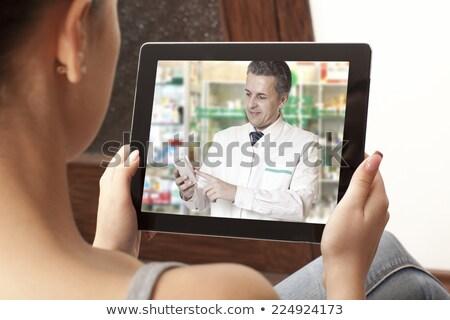 Kobieta wideo chat farmaceuta laptop muzyka Zdjęcia stock © dolgachov