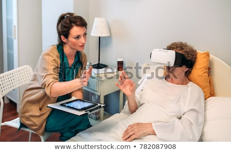 The patient in the hospital with vr glasses headset Stock photo © Elnur