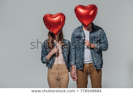 girl hiding behind red heart shaped balloon Stock photo © dolgachov