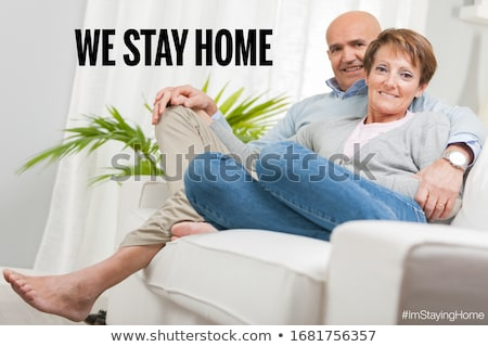 old couple saving themselves from coronavirus staying home Stock photo © Giulio_Fornasar